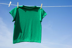 Green T-Shirt on a Clothesline Royalty Free Stock Images