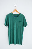 Green t-shirt on hanger Stock Photos
