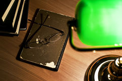 Green table lamp and  book, glasses Stock Photo