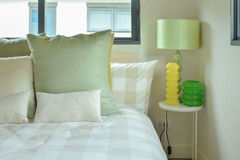 Green table lamp with green color scheme bedding Royalty Free Stock Photography