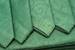 Green tablecloth and napkin Stock Photography