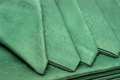 Green tablecloth and napkin Royalty Free Stock Photo