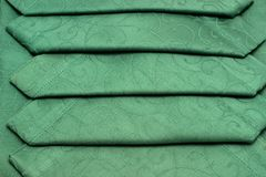 Green tablecloth and napkin Stock Images