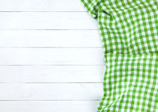 Green tablecloth on white wood table. Green towel over wooden kitchen table. View from above Stock Images