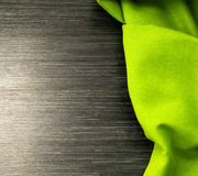 Green tablecloth on wooden table for background. Fabric texture.Top view. Green tablecloth on wooden table for background. Wooden texture. Space for text Stock Images