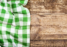 Green tablecloth on wooden table Royalty Free Stock Images
