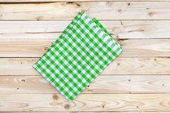 Green tablecloth on wooden table, top view Royalty Free Stock Photos