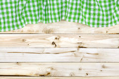 Green tablecloth on wooden table, top view Royalty Free Stock Images