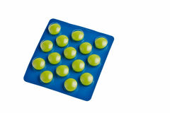 Green tablets. Green tablets in blue package isolated over white background Royalty Free Stock Images