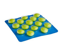 Green tablets. Green tablets in blue package isolated over white background Royalty Free Stock Photography