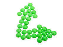 Green tablets in arrow formation Stock Image
