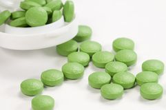 Green tablets near the box Royalty Free Stock Photo