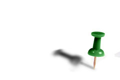 Green Tack with shadow. A green tack standing up with shadow, white copyspace Royalty Free Stock Images
