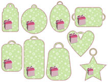 Green tag collection with pink gifts Stock Photography