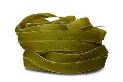 Green tagliatelle pasta Stock Photo