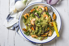 Green tagliatelle with seafood. Mussels; Prawns Royalty Free Stock Images