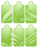 Green tags with hearts and abstract shapes. Green tags with hearts, stars and circles over white background Stock Images