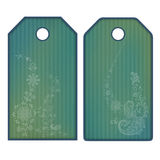 Green tags or labels with flowers. Isolated on white Royalty Free Stock Photo