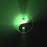 Green Tai Chi Yin Yang symbol bright flare. Isolated Yin Yang symbol shinning with mystery green light flares. Oriental cultural sign of balance opposite Royalty Free Stock Images