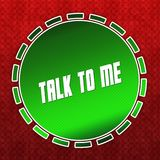 Green TALK TO ME badge on red pattern background. Stock Photos