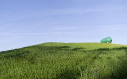 Green tank on a green hill Royalty Free Stock Photo
