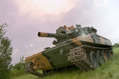 Green Tank in Purple Haze Stock Images