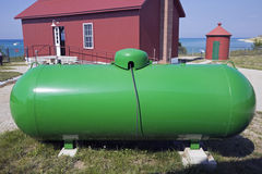 Green Tank, Red Shed Royalty Free Stock Photos