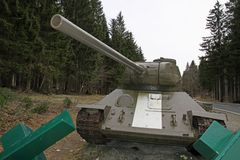 Green tank used during the war in defense of the roadblock Stock Images
