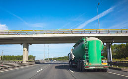 Green tanker truck goes on highway, rear view Royalty Free Stock Photos