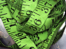 Green tape measure Stock Photo