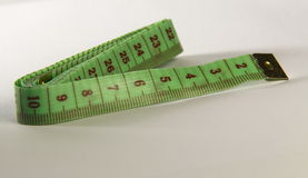 Green tapemeasure royalty free stock images