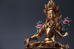 Bronze figurine of a green Tara with copyspace. Royalty Free Stock Photo