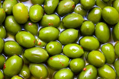 Green tasty spicy olives background Royalty Free Stock Photography