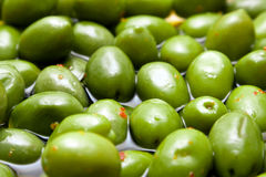 Green tasty spicy olives closeup Royalty Free Stock Image