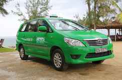 A green taxi in Hoi An, Vietnam Royalty Free Stock Image