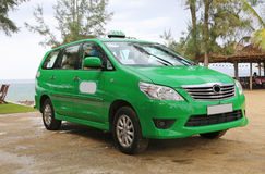 A green taxi in Hoi An, Vietnam Royalty Free Stock Photography
