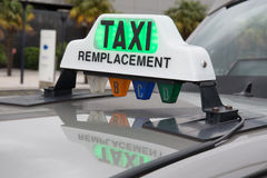 Green taxi sign in France on the car stock photography
