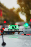 Green taxi sign in Paris Stock Photo