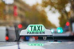 Green taxi sign in Paris Stock Image