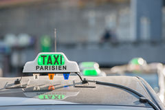 Green taxi sign in Paris, France stock photos