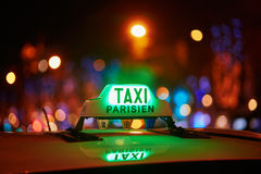 Green taxi sign in Paris, France. Green taxi sign at night in Paris, France Royalty Free Stock Photo