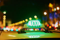 Green taxi sign in Paris, France. Green taxi sign at night in Paris, France Stock Photography