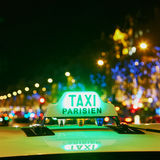 Green taxi sign in Paris, France. Green taxi sign at night in Paris, France Royalty Free Stock Photos