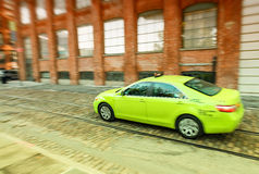 Green taxi speeding up in Brooklyn, New York City Royalty Free Stock Photo