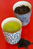 Green Tea. And Tea Leaves on red tray Stock Photography