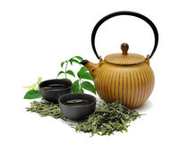 Green Tea. Chinese Long Jing green tea with small pot and cups isolated on white royalty free stock photos