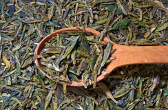 Green tea. Wooden spoon with a green tea Royalty Free Stock Photography