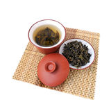 Green tea. Chinese green tea in the ceramic bowl with cover and tea leaves Stock Image