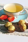 Green Tea. A Cup of green Tea With Chocolate and Strawberry royalty free stock images