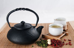 Green tea. A iron teapot and two cups filled with green tea Stock Photography